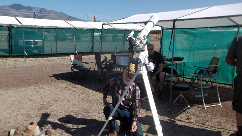 Joe, W7LUX, sets up solar telescope for interested people to see the sun.