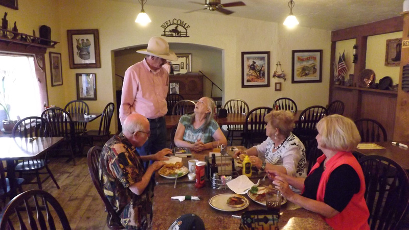 Mayor John Moore stops by to speak with Doris, husband Ralph and others having lunch before the book signing.