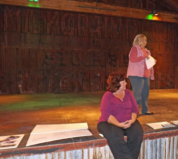 Producer Kerry-Lynn Moede (sitting) and Cosette Riggs (standing) explain the vision of the upcoming Christmas Pageant.